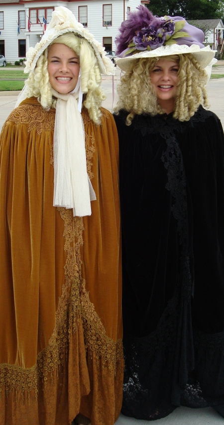 Dickens on The Strand Ladies in Victorian Cloaks, Hats and Bonnets