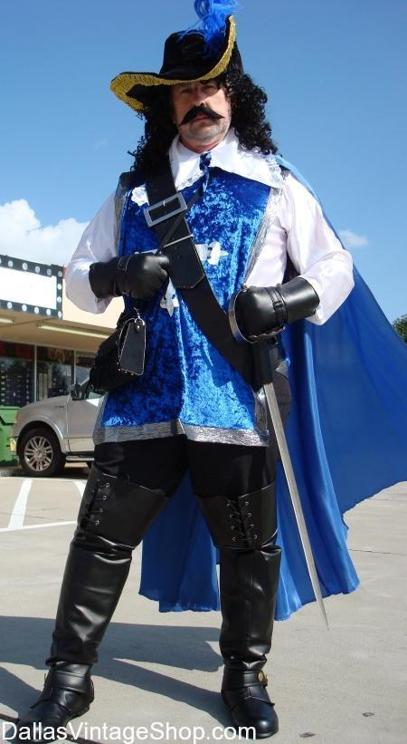 Three Musketeers Costumes, Musketeers Blue Tabard Costume, Three Musketeers Movie Costumes, Three Musketeers Classic Costumes, Three Musketeers Hats, Three Musketeers Period attire, Three Musketeer Theatrical Costumes, Three Musketeers Quality Costumes, Three Musketeers Economy Costumes, Three Musketeers Baldrics, Three Musketeers Sword & Sword Belts, Three Musketeers Costumes:,  Musketeers Blue Tabard Costume, Musketeer Complete Outfits, Musketeer Baldrics & Swords