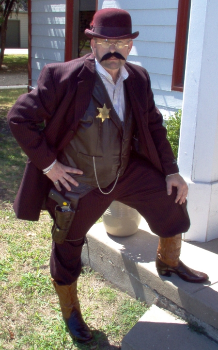 Look at this example of one of our Wild West Excellent Quality Men's Lawmen Outfits shown here. Get Wild West Town People Costumes too. Whatever the Wild West Lawman, we have a Costume for that. Get Wild West Sheriff Costumes, Wild West Marshal Costumes, Wild West Deputy Costumes, Wild West Quality Men's Suits , Wild West Bowler Hats, Wild West Theatrical Costumes, Wild West 1800's Attire, Wild West Authentic Period Attire, Wild West Authentic Hats, Wild West Cowboy Hats and whatever Acessories you need are in Stock. We are open all year round.