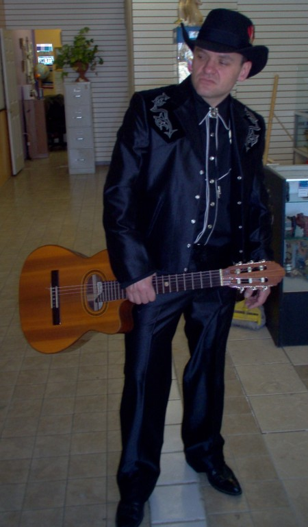 We have Racks of Country Music Costumes like this Johnny Cash Country Singer Outfit. We also have Country Music Costumes, Country Music CMA Costumes, Country Music Stars Costumes, Country Music Entertainers Costumes, Country Music Theatrical Costumes, Country Music Artist Costumes, Country Music Ring of Fire Costumes, Country Music Johnny Cash Costume, Country Music Legends, Country Music Male Artists, Classic Country Music Celebrities Costumes, Country Music Fancy Western Wear Costumes and Accessories in stock.